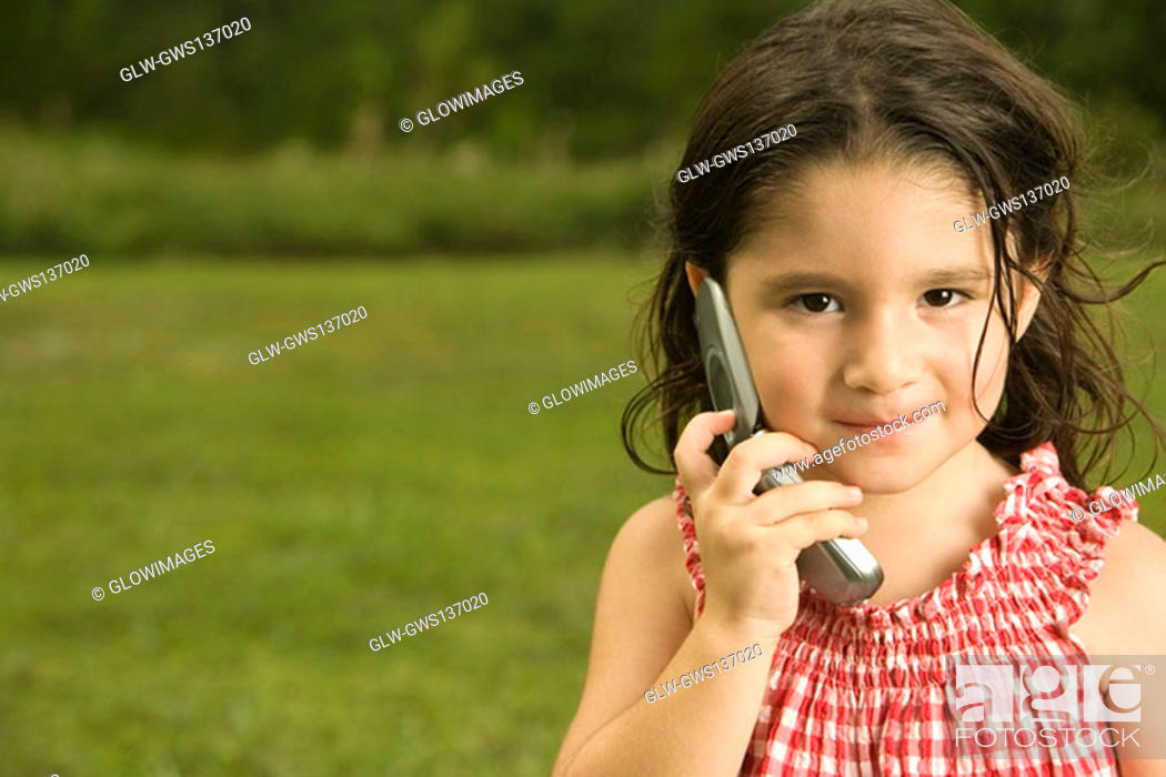 Stock Photo: Portrait of a girl talking on a mobile phone.