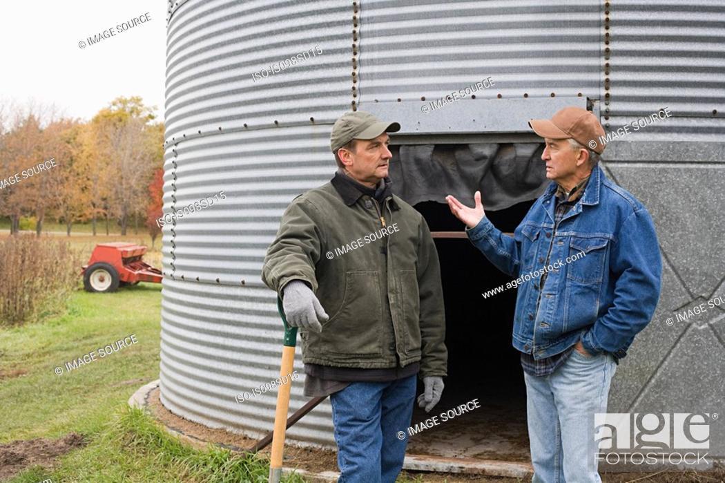 Stock Photo: Farmers talking.