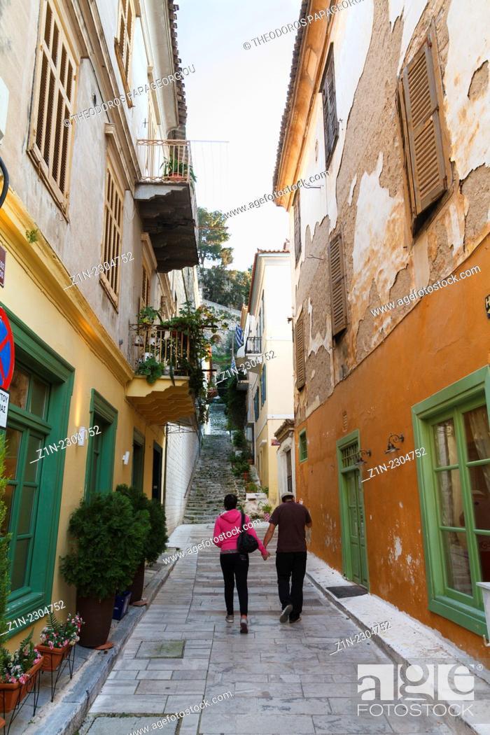 Stock Photo: A couple walking at alley in Nafplion city. Argolis, Peloponnese, Greece.