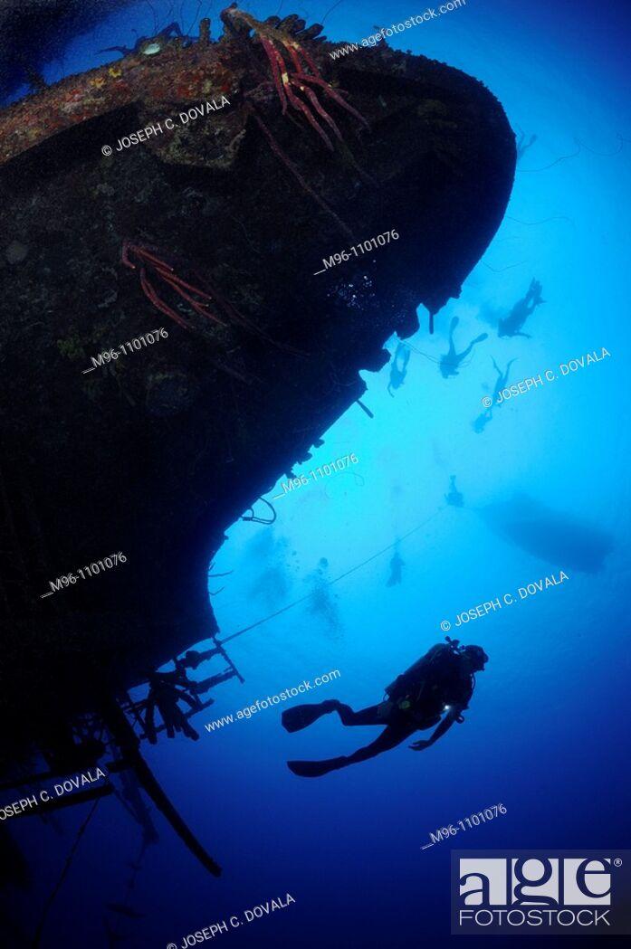 Stock Photo: Scuba divers explore ship wreck, Hilma Hooker, Bonaire Island, Netherlands Antilles, Caribbean.