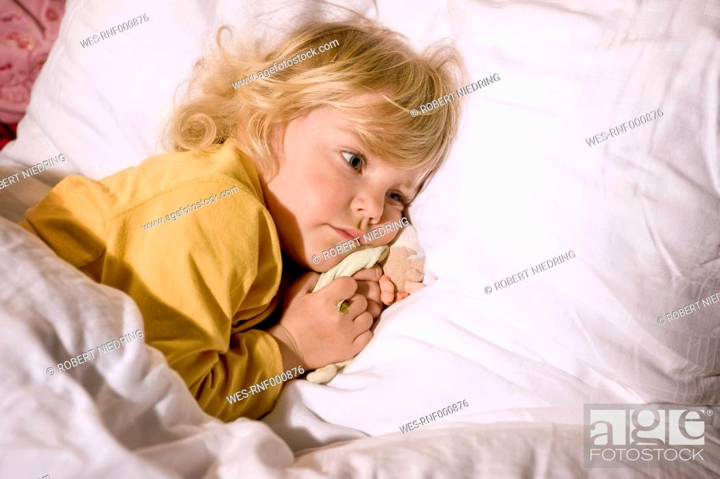 Stock Photo: Girl lying on bed.