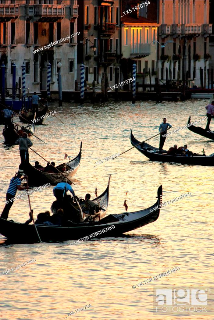 Stock Photo: Gondolas carrying tourists on Grand Canal in Venice.