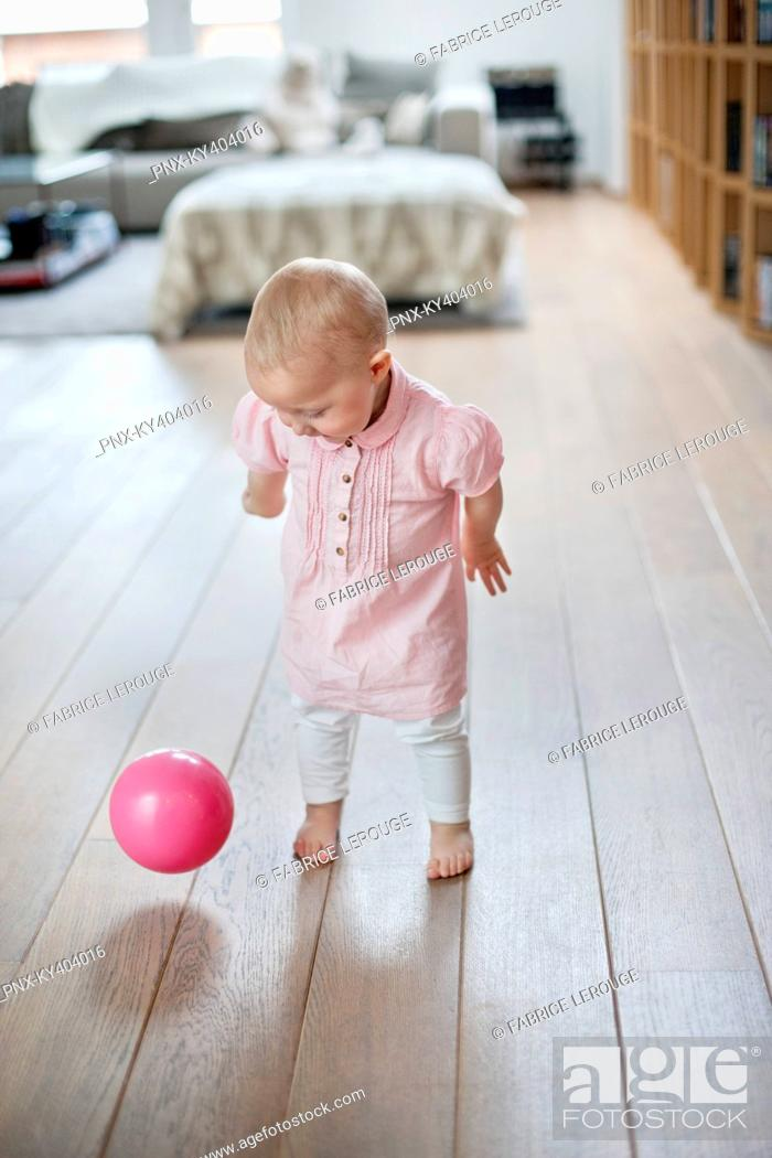 Stock Photo: Baby girl playing with a ball.