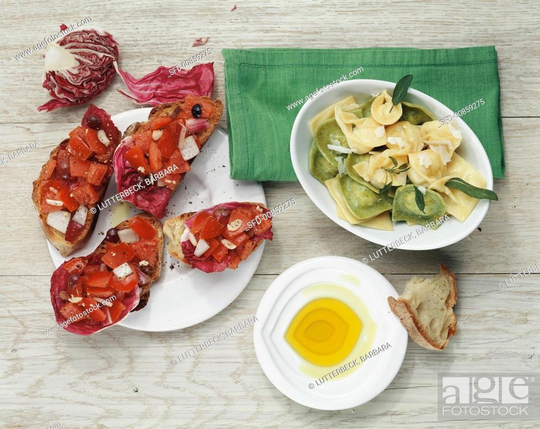 Stock Photo: Tortellini with sage & olive oil & bruschetta with radicchio.