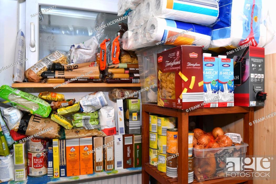 Stock Photo: Cramped cellar room with whitewashing on after Hamsterkaeufen on March 27th, 2020 due to corona, pandemic, spread, corona crisis, corona virus, virus, pathogen.