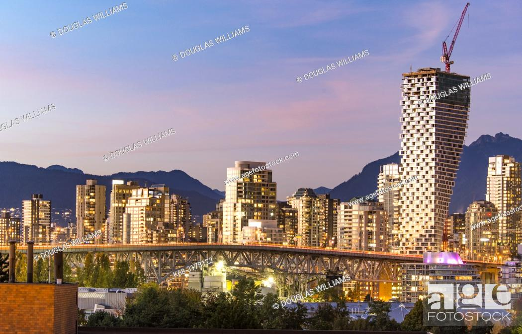 Stock Photo: Skyline at twilight, with Vancouver House tower on right, Vancouver, BC, Canada.