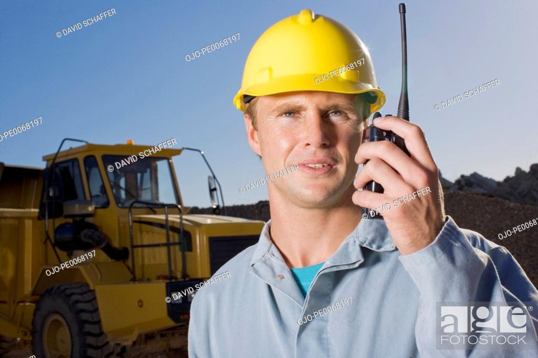 Stock Photo: Construction worker talking on walkie-talkie.