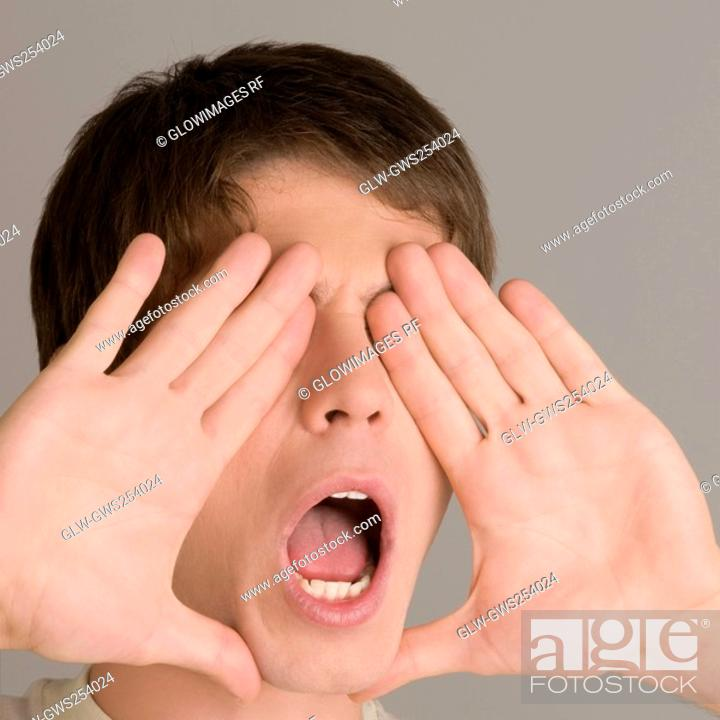 Stock Photo: Close-up of a young man shouting.