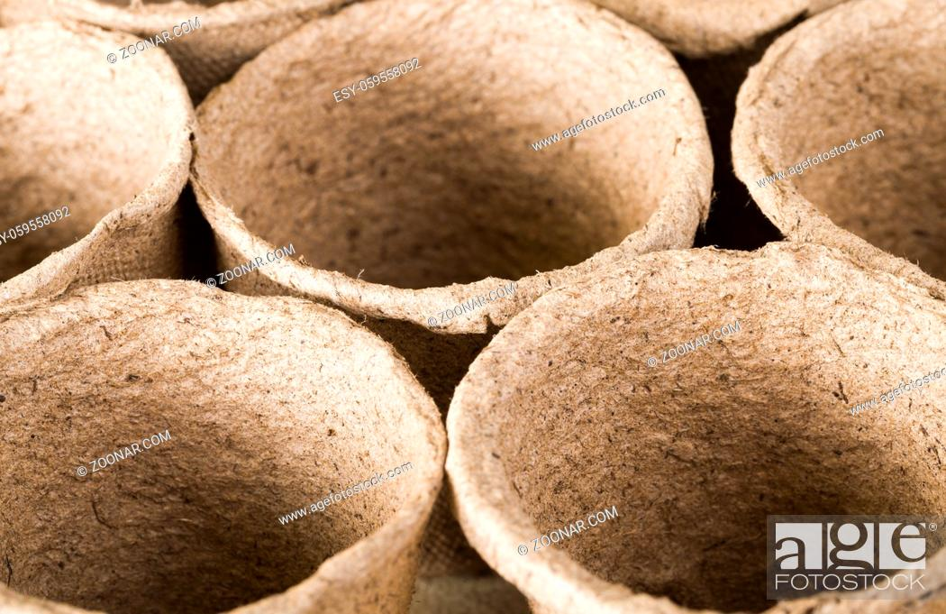Stock Photo: Small paper pots are made from cellulose and peat for growing seedlings and getting a big crop of crops.