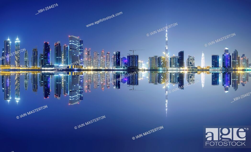 Stock Photo: Night view of Burj Khalifa and Creek at new Business Bay district of Dubai United Arab Emirates.