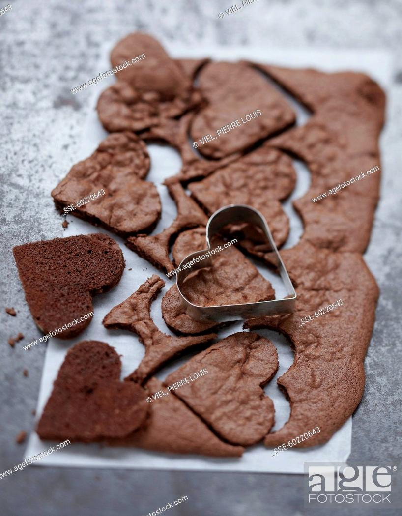 Stock Photo: Cutting chocolate hearts with a biscuit cutter.