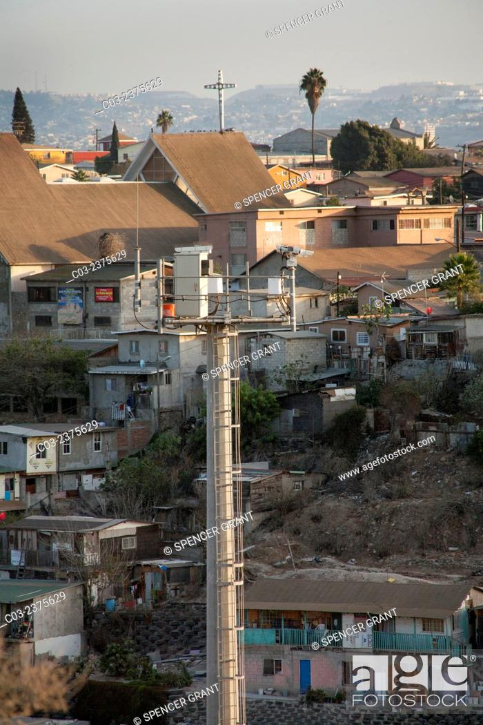 Stock Photo: Opposite the international fence at the Colonia Libertad district of Tijuana on the U.S./Mexico border a television watchtower surveys attempts at illegal.