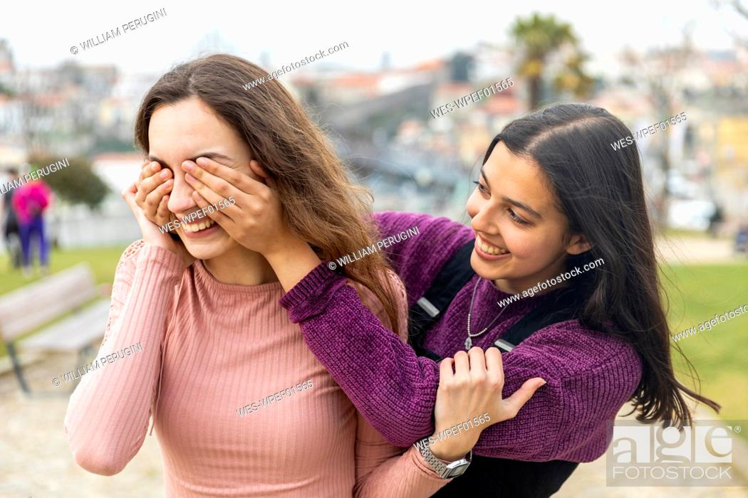Stock Photo: Two young women having fun in the city, Porto, Portugal.