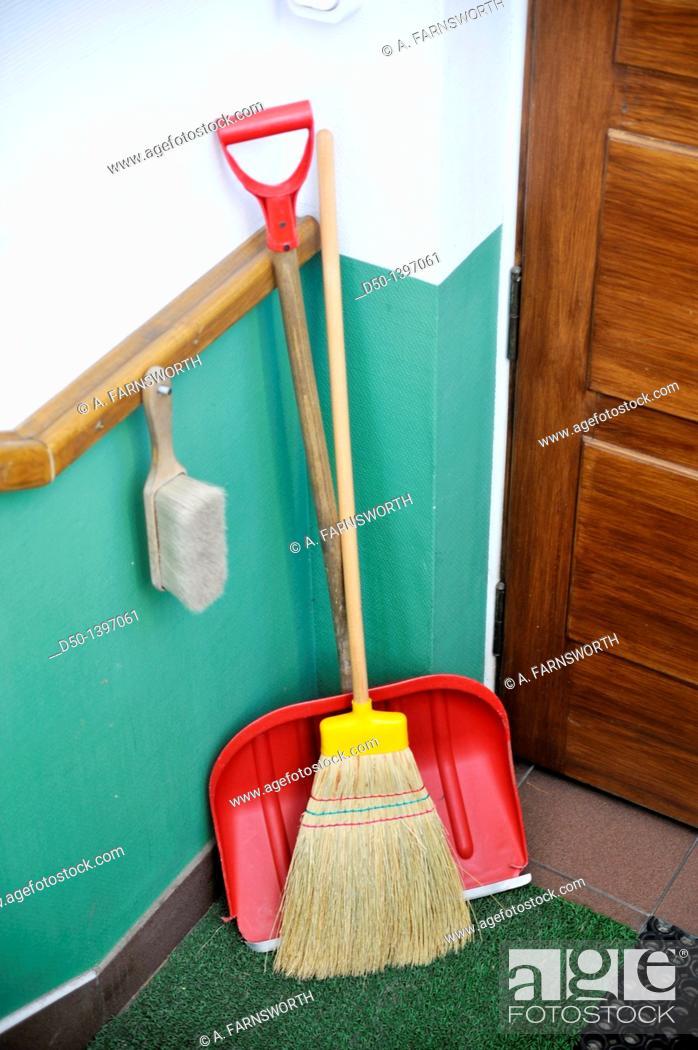 Stock Photo: Winter utensils at a hotel: broom, brush and snow shovel, Zakopane, Poland.
