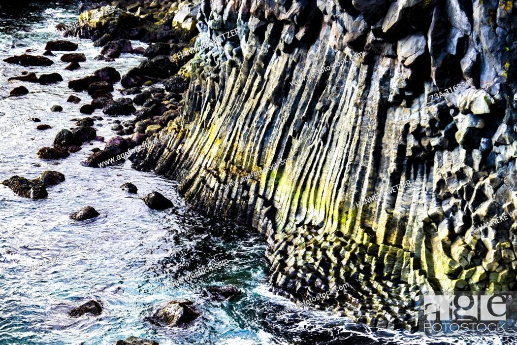 Stock Photo: Closeup of columnar basalt cliffs at Arnarstapi in Iceland.