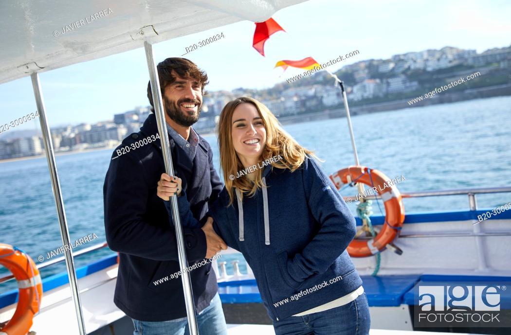 Imagen: Couple on a boat trip to Santa Clara Island, La Concha Bay, Donostia, San Sebastian, Gipuzkoa, Basque Country, Spain, Europe, Winter.