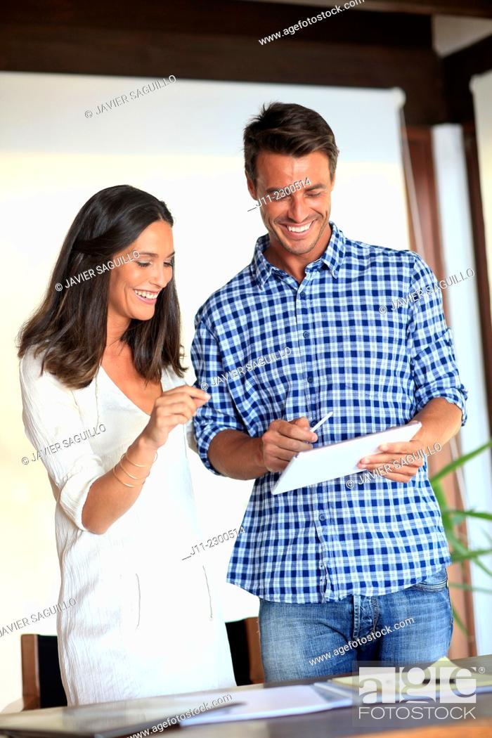 Stock Photo: Couple with digital tablet.