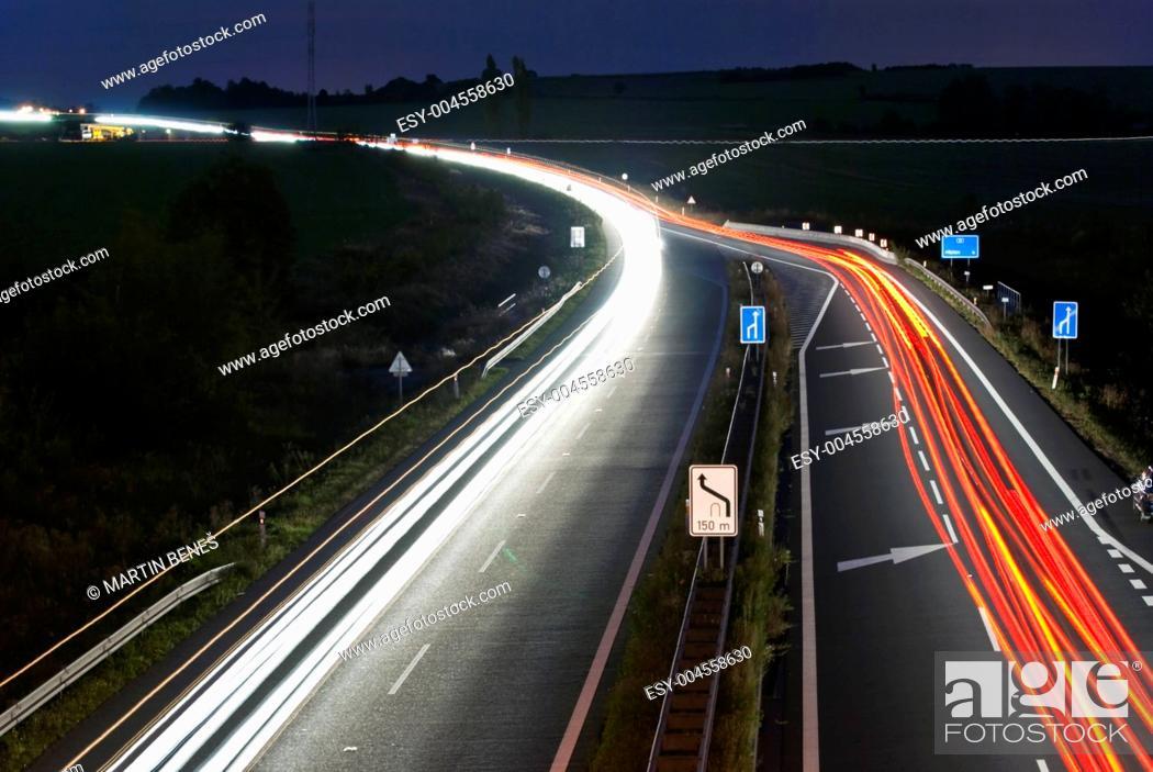 Stock Photo: Night highway - long exposure - car light lines.