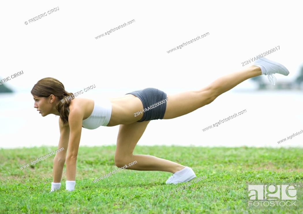 Stock Photo: Young woman working out, outdoors.