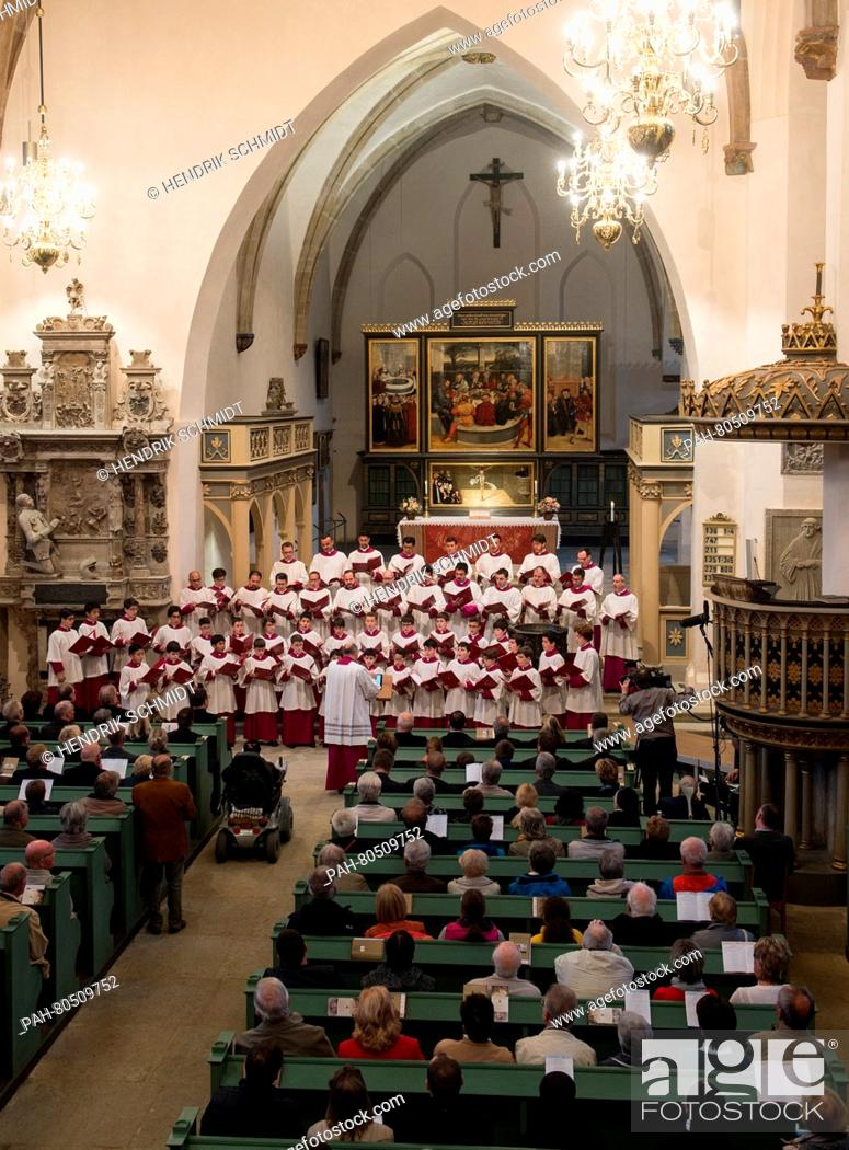 Stock Photo: The Vatican-based Sistine Chapel Choir led by its director Massimo Palombella performs during an ecumenical concert held at the St.
