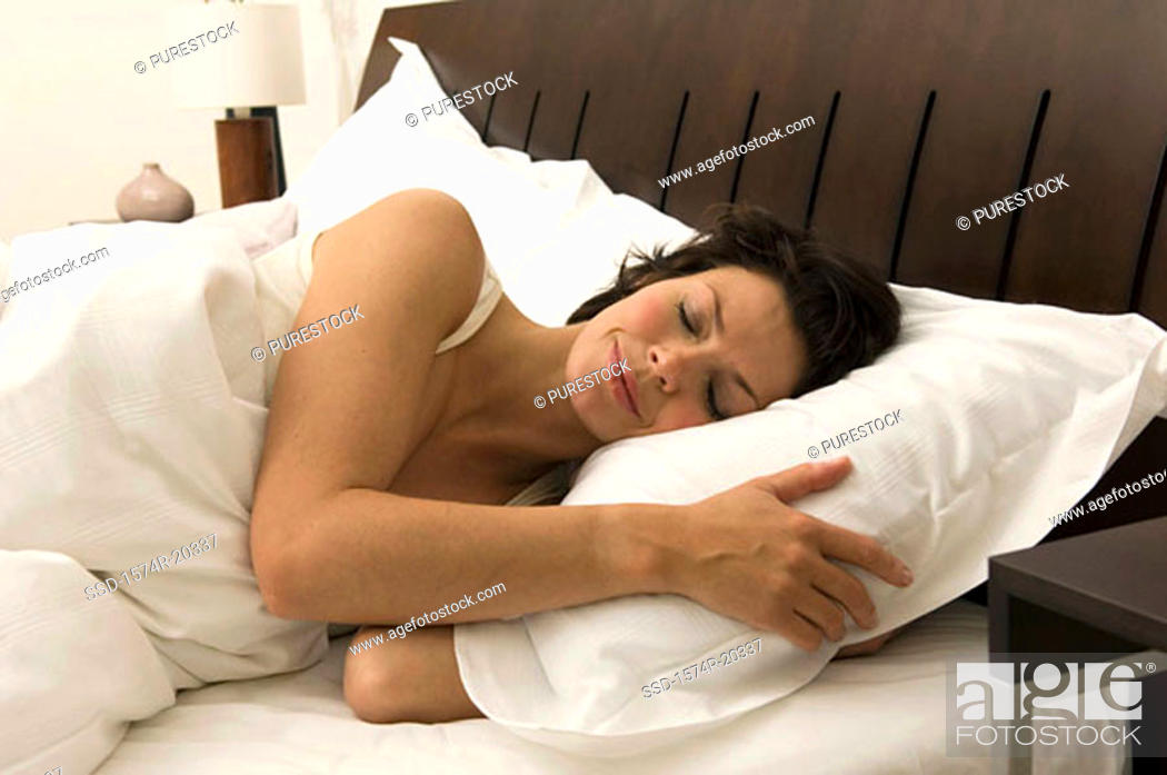 Stock Photo: Close-up of a young woman sleeping in the bed.