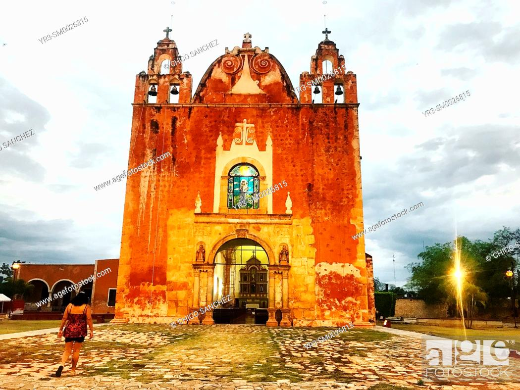 Stock Photo: A Mexican woman visits the church of Ticul, Yucatan, Mexico.