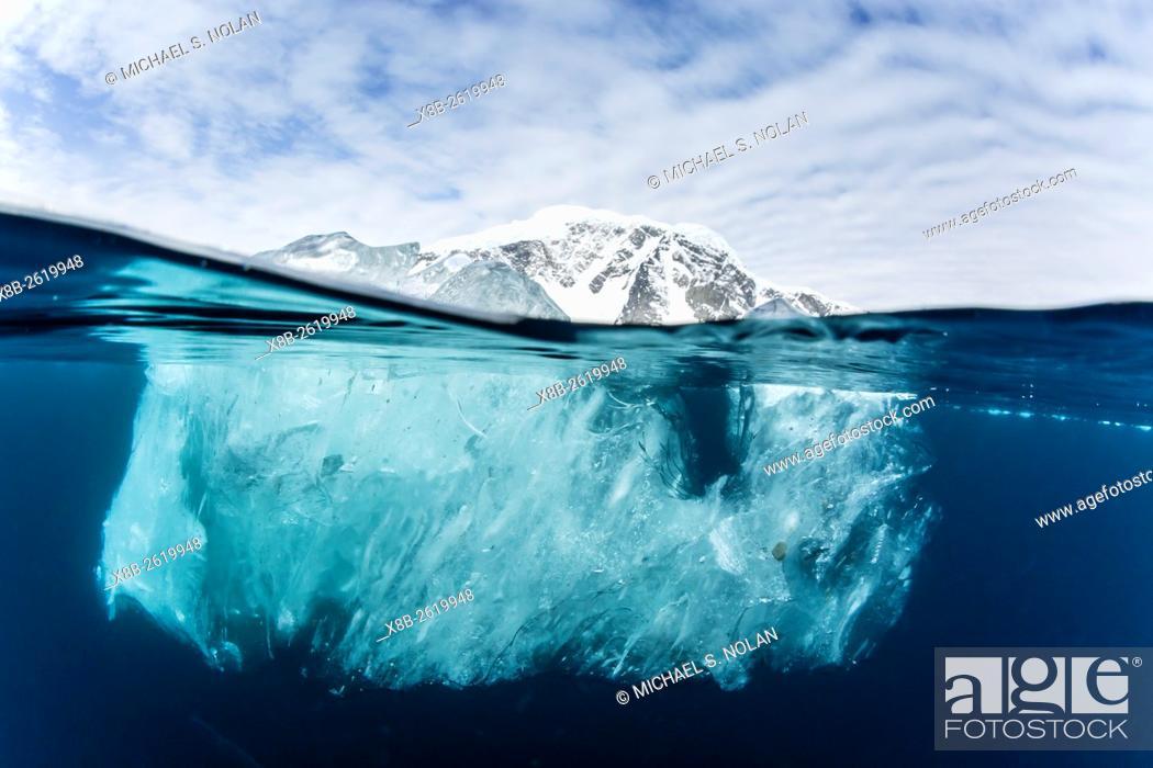 Stock Photo: Above and below water view of Danco Island, Errera Channel, Antarctica.