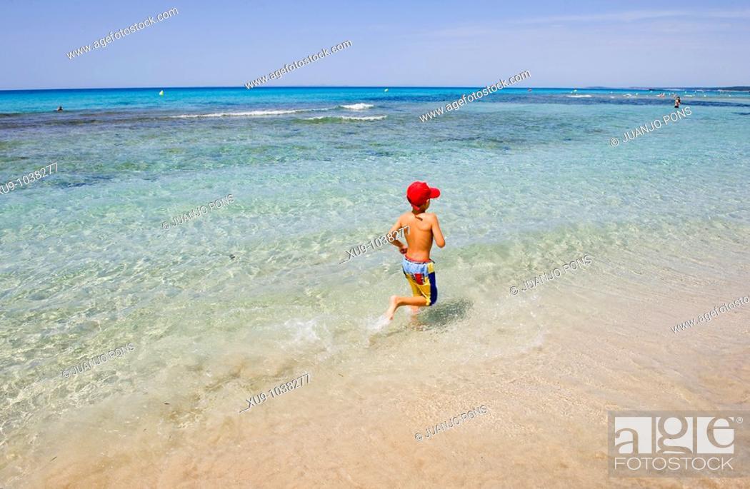 Stock Photo: Boy running on beach.