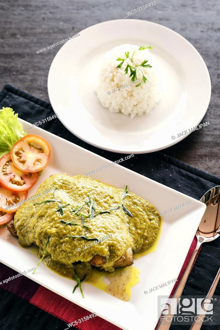 Stock Photo: thai fish fillet with asian green curry sauce meal and rice.