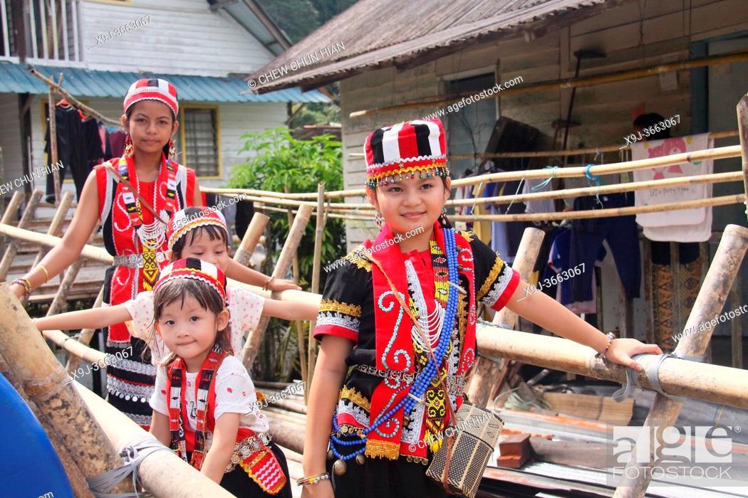 Stock Photo: Celebrating Gawai with traditional costume at long house near kuching city, Sarawak, Malaysia.