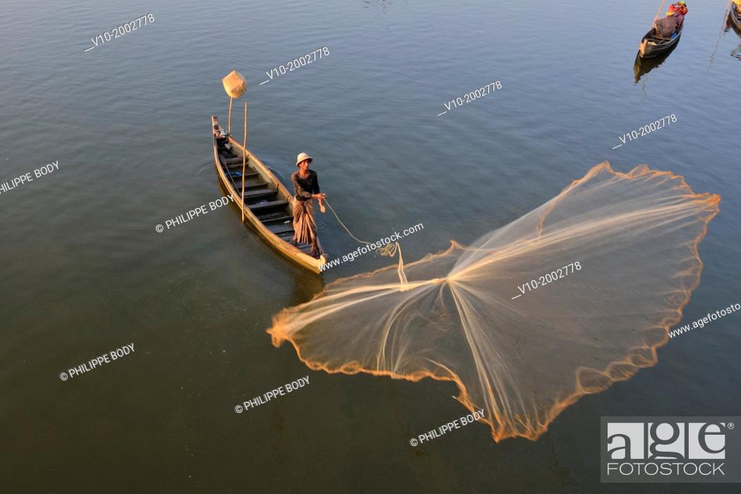 Stock Photo: Burma, Myanmar, Amarapura, U Bein, lake Taungthman and cast net fishing.