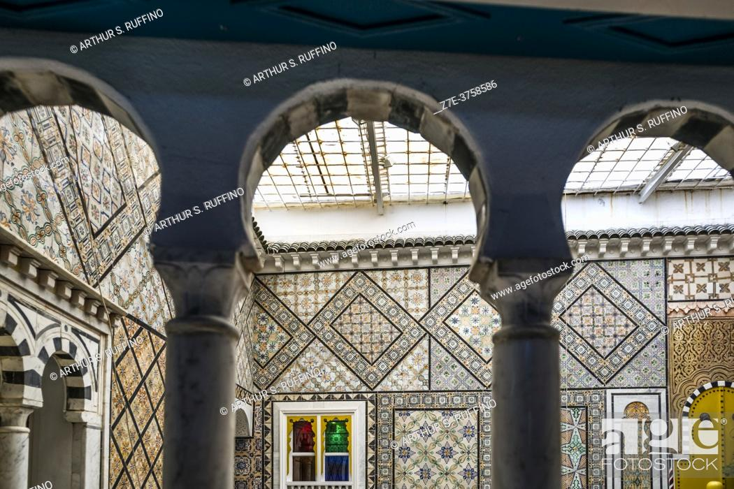 Stock Photo: The stunning interior of a retail shop selling traditional arts and crafts. Walls are decorated with gorgeous tiles. Sidi Bou Said, Tunisia, Africa.