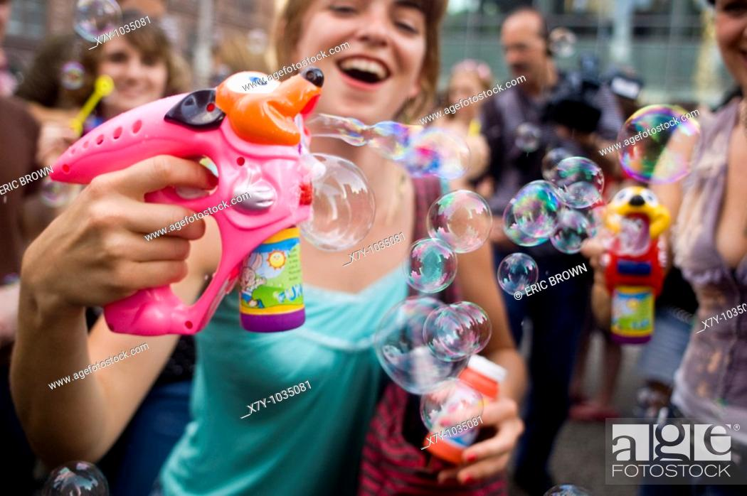 Stock Photo: Participants in a 'Bubble Battle,' whereby strangers gather at a particular place and time, and make bubbles in any way possible.