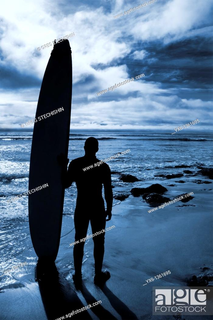 Stock Photo: A surfer preparing for an afternoon of surfing on the Californian coast  Santa Cruz, US.