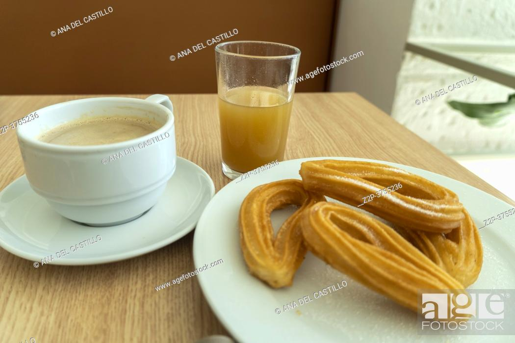 Stock Photo: Breakfast in Spain with coffee orange juice and churros.