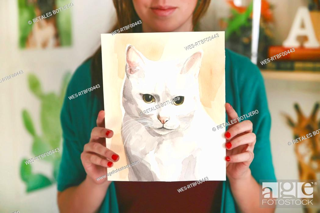 Stock Photo: Artist showing aquarelle of a cat.