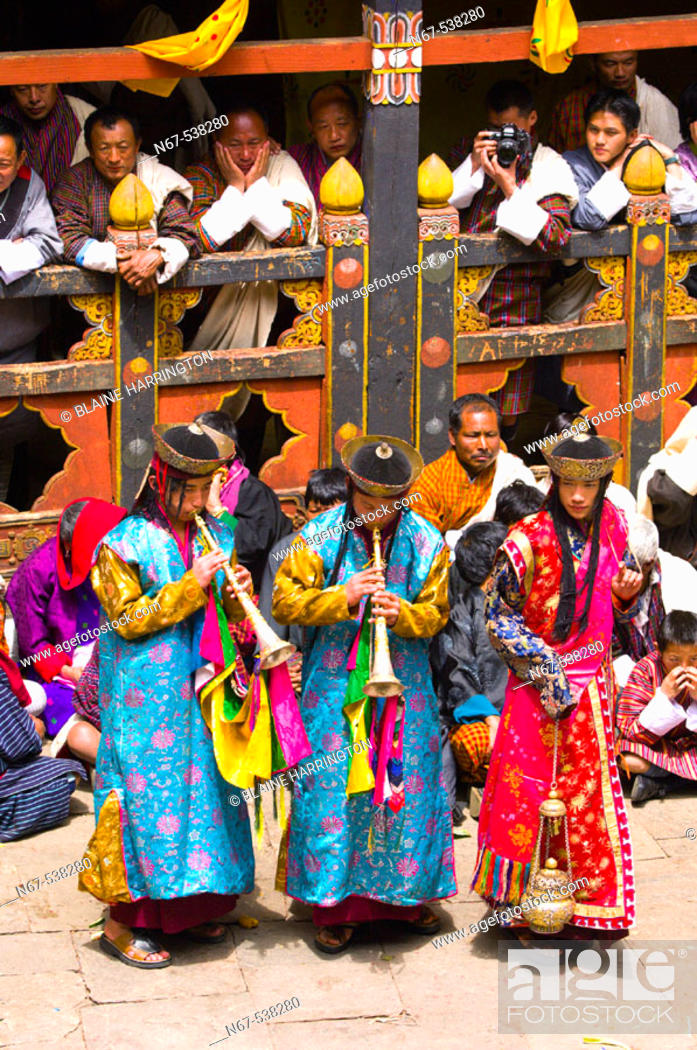Stock Photo: Musicians play horns, Paro Tsechu (festival), Paro Dzong, Paro, Bhutan.
