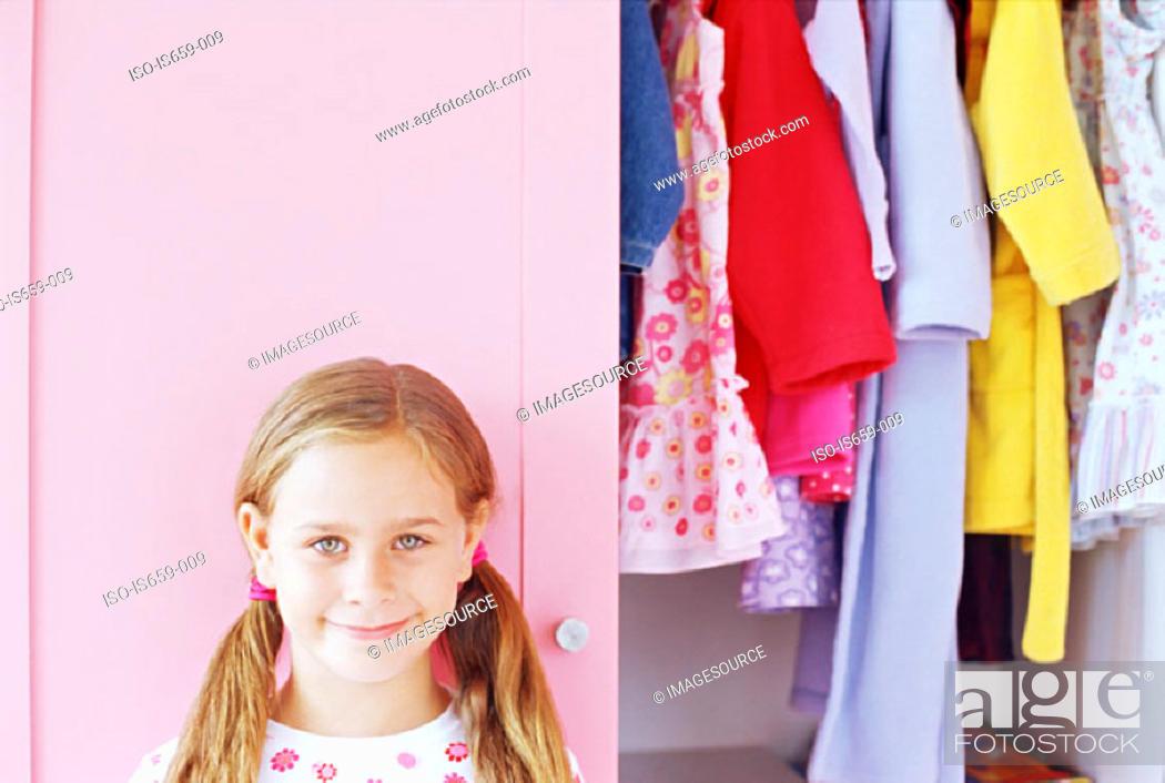 Stock Photo: Girl by her wardrobe.