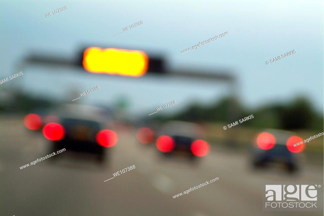 Stock Photo: Blurred tail lights of cars travelling on a highway, Paris, France.