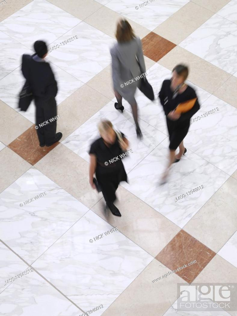 Stock Photo: Business people walking elevated view long exposure.