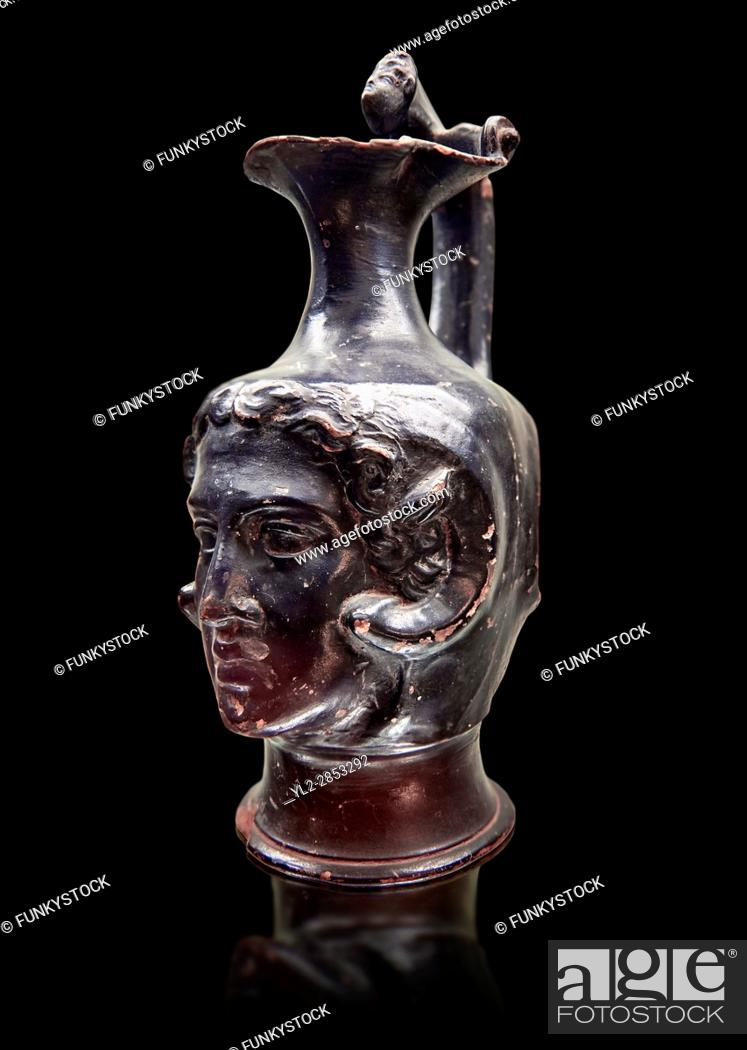 Stock Photo: Etruscan bucchero jug with a face, National Archaeological Museum Florence, Italy , black background.