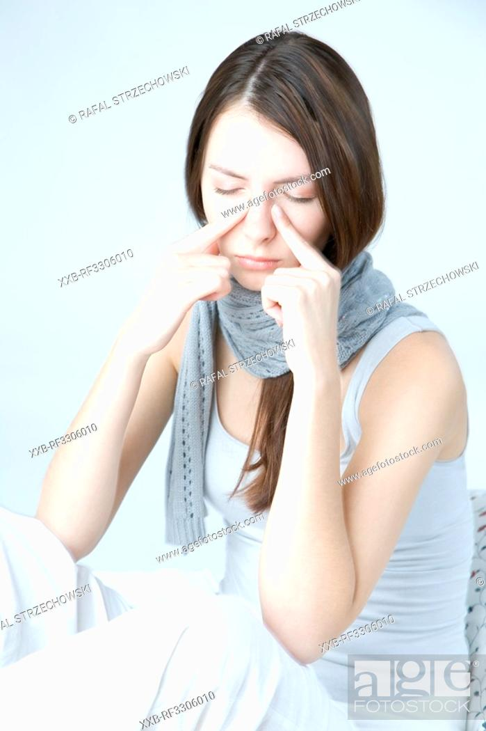 Stock Photo: young woman with sinuses pain.
