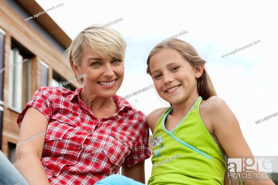 Stock Photo: Germany, Bavaria, Nuremberg, Mother and daughter smiling, portrait.