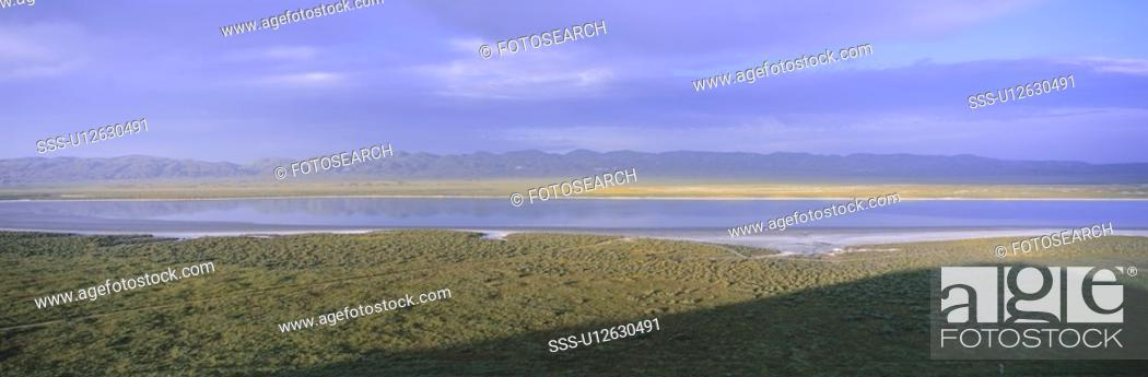 Stock Photo: Panoramic view of lake at sunset.