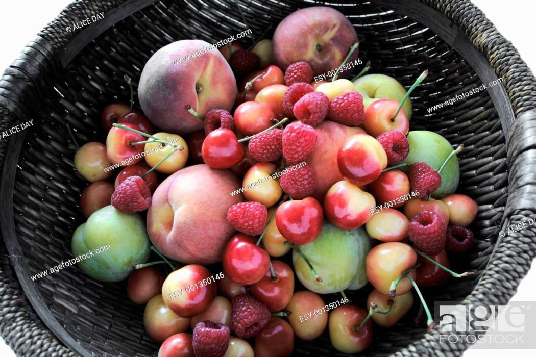 Stock Photo: peaches, plums, raspberries, Rainier cherries.