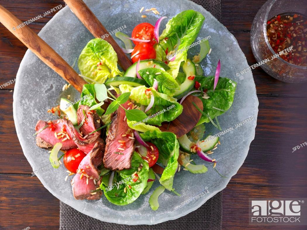 Stock Photo: Hot Thai salad with steak strips.