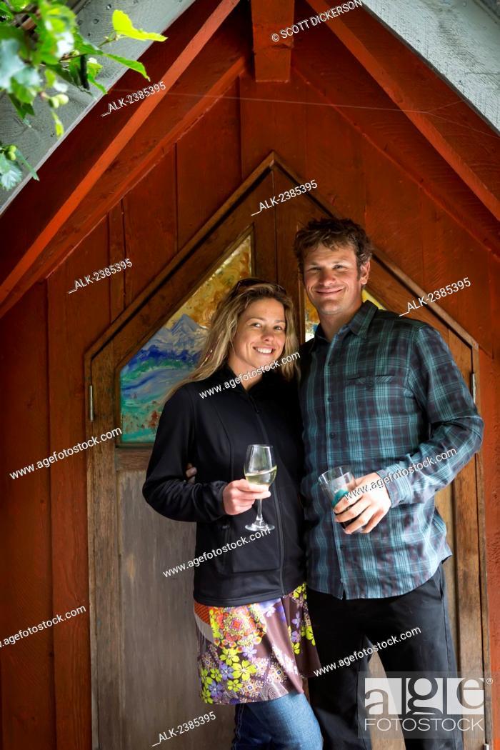 Imagen: Visiting couple pose along the boardwalk, Halibut Cove, Southcentral Alaska.