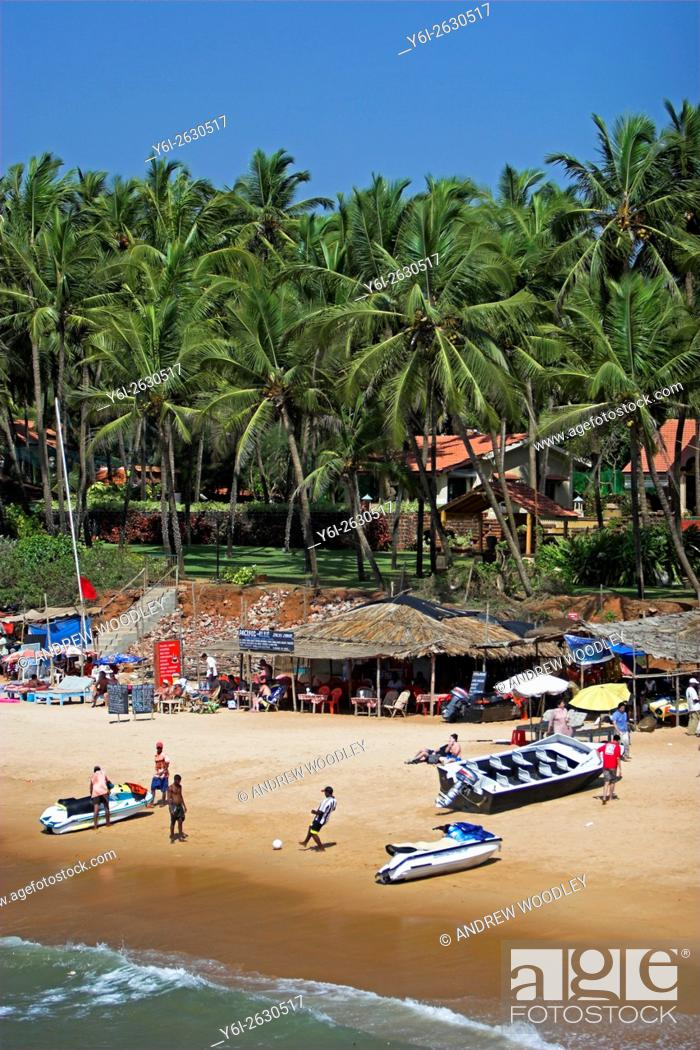 Stock Photo: Boat and personal water craft on Sinquerim Beach near Fort Aguada and Taj Holiday Village Goa India.