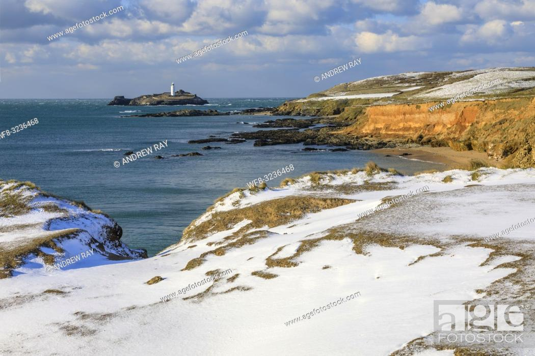 Stock Photo: Godrevy lighthouse on the eastern side of St Ives Bay in Cornwall captured after a snowfall on an afternoon in late February.