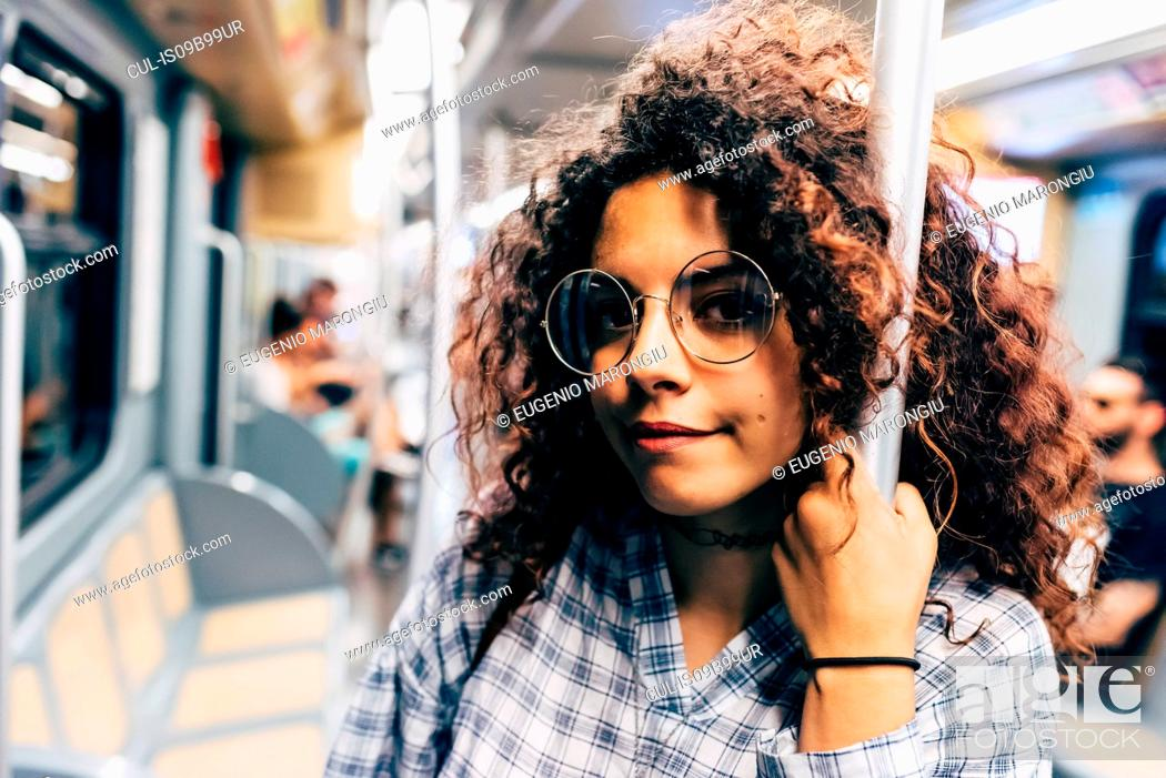 Stock Photo: Woman in public transport, Milan, Italy.